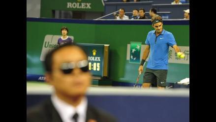 FOTOS: Guardaespaldas resguardan a Roger Federer hasta cuando juega