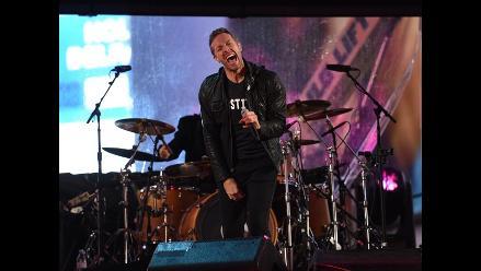 U2: Chris Martin de Coldplay y Bruce Springsteen en el escenario