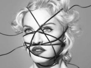 Madonna se defiende de críticas por fotos de Mandela