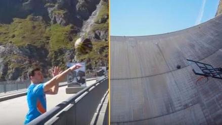 Desafían las leyes de la física y encestan canasta desde 180 metros de altura