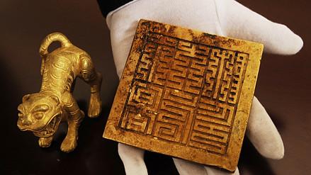 Encuentran en un río en China un tesoro con 10,000 objetos de oro y plata