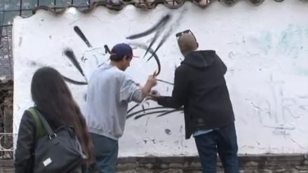 Expulsan del país a grafiteros que dañaron muros en centro histórico