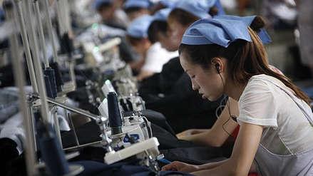 La industria manufacturera de China se enfría por la guerra comercial y los tifones