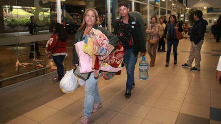 Casi 100 venezolanos regresaron a su país en avión enviado a Perú por Maduro