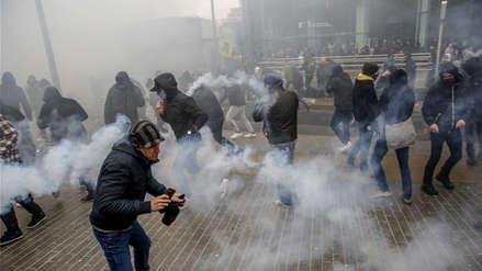 Tensión en Bruselas: violentas manifestaciones contra el pacto migratorio de la ONU [Fotos]