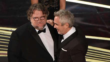 Oscar 2019: Alfonso Cuarón recibe el premio a Mejor Director de manos de Guillermo del Toro