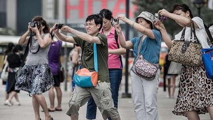 Guerra comercial | China utiliza el turismo para debilitar la economía de Estados Unidos