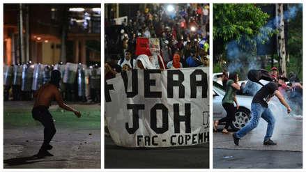 Gases lacrimógenos, choques y represión: 15 fotos de la violenta protesta contra el presidente de Honduras