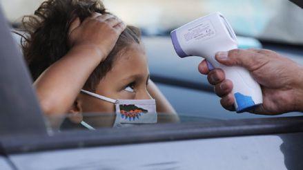 Niños con COVID-19 presentan con más frecuencia fiebre y tos que con la gripe