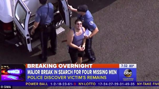 DiNardo sonríe a la prensa mientras es arrestado.