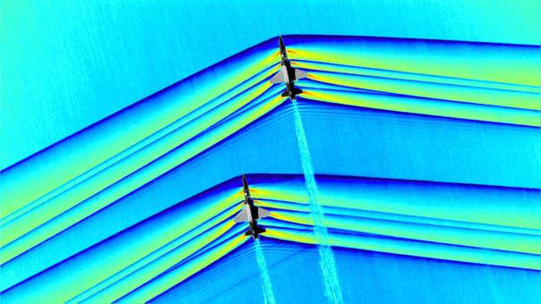 Composición colorizada de dos aviones cruzando la barrera del sonido.