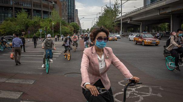 Ciudadanos con mascarillas en Pekín, la capital de China.