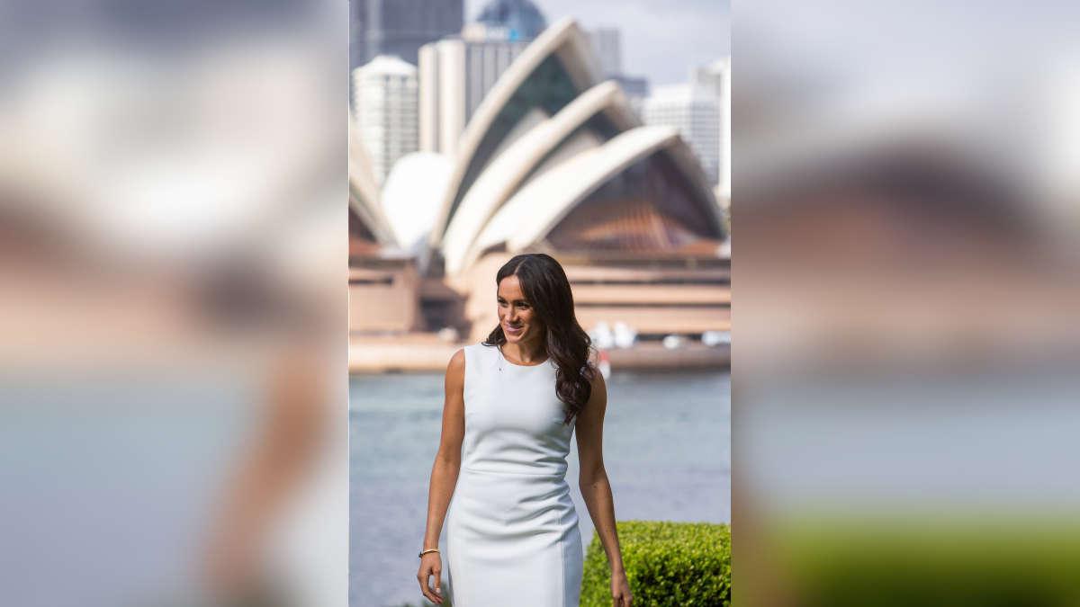 Meghan Markle lució un ceñido venstido blanco donde se deja ver su embarazo. Aproximadamente, estaría cerca de los cuatro de gestación. | Fuente: AFP | Fotógrafo: STEVE CHRISTO